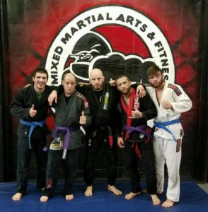WNY MMA Members Celebrating Belt Promotions